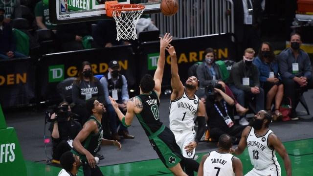 Boston Celtics forward Jayson Tatum (0), center Tristan Thompson (13) and Brooklyn Nets forward Bruce Brown (1)