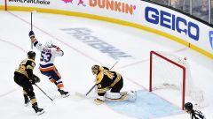 Boston Bruins defenseman Jeremy Lauzon, New York Islanders forward Casey Cizikas