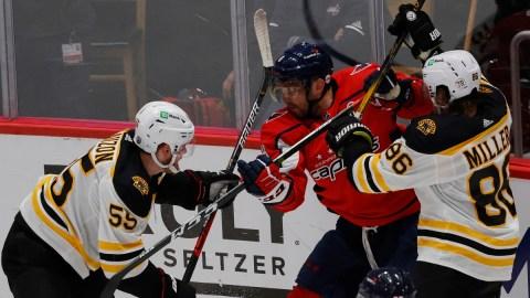 Boston Bruins defensemen Kevan Miller and Jeremy Lauzon, Washington Capitals winger Alex Ovechkin