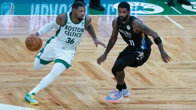Boston Celtics guard Marcus Smart and Brooklyn Nets guard Kyrie Irving