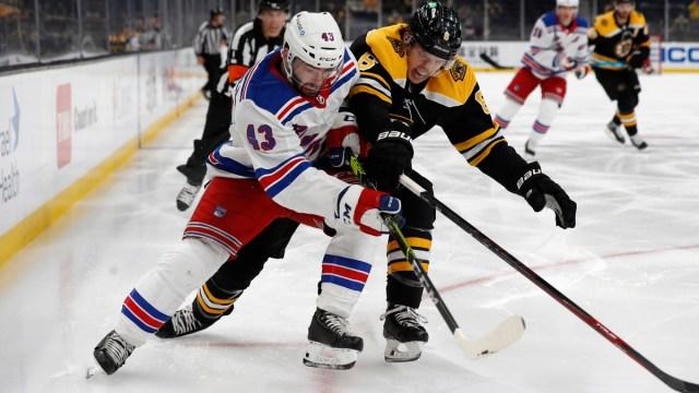 Boston Bruins defenseman Mike Reilly, New York Rangers forward Colin Blackwell