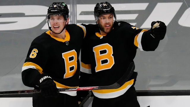 Boston Bruins left wing Taylor Hall (71) and defenseman Mike Reilly (6)