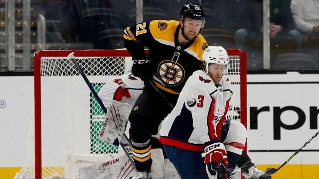 Washington Capitals defenseman Nick Jensen (3) and Boston Bruins left wing Nick Ritchie (21)