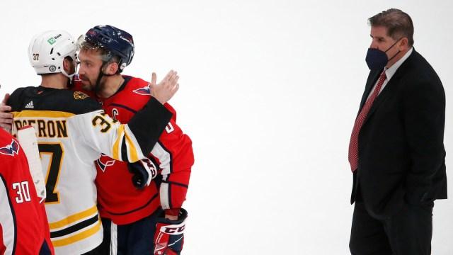 Boston Bruins captain Patrice Bergeron, Washington Capitals winger Alex Ovechkin, head coach Peter Laviolette