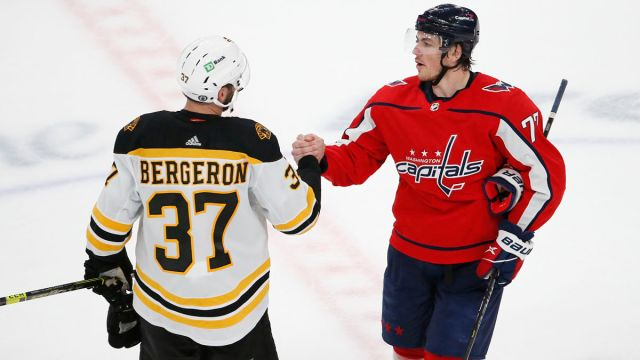 Boston Bruins center Patrice Bergeron and Washington Capitals right wing T.J. Oshie