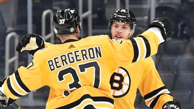 Boston Bruins forwards Patrice Bergeron, Taylor Hall