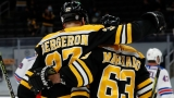 Boston Bruins Forwards Patrice Bergeron And Brad Marchand