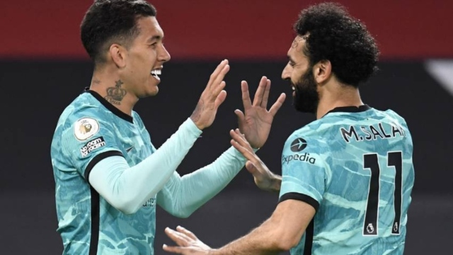Liverpool forwards Roberto Firmino (left) and Mohamed Salah