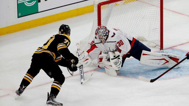 Boston Bruins left wing Taylor Hall and Washington Capitals goalie Ilya Samsonov