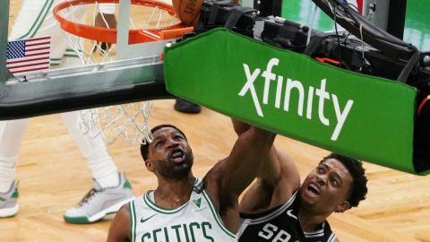 Boston Celtics center Tristan Thompson, San Antonio Spurs' Keldon Johnson