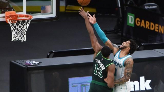 Boston Celtics center Tristan Thompson (13) and Charlotte Hornets forward Miles Bridges (0)