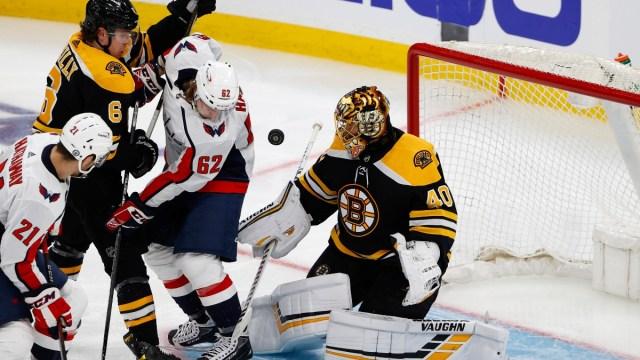 Boston Bruins goaltender Tuuka Rask (right) and Washington Capitals left wing Carl Hagelin (62)