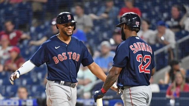 Boston Red Sox shortstop Xander Bogaerts (left) and infielder Danny Santana (22)