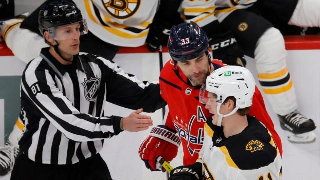 Boston Bruins forward Trent Frederic, Washington Capitals defenseman Zdeno Chara