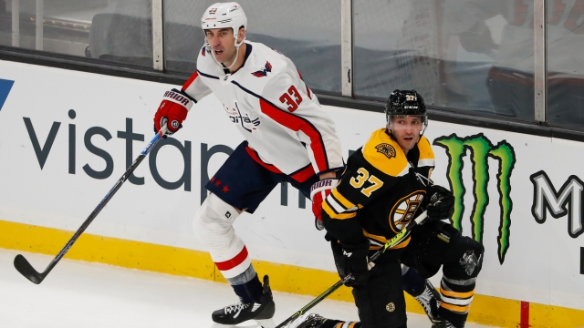 Washington Capitals Defenseman Zdeno Chara And Boston Bruins Center Patrice Bergeron