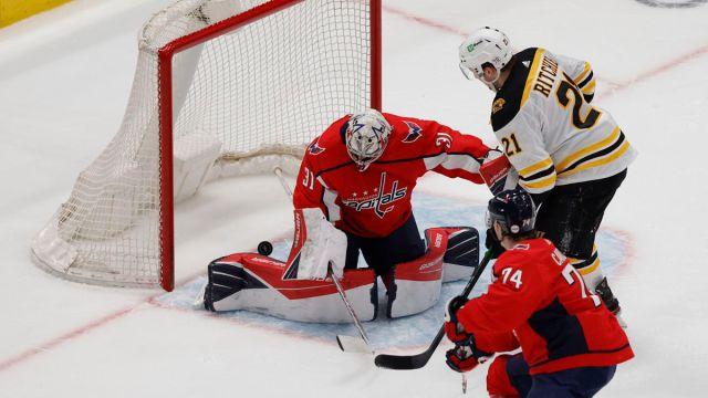 Washington Capitals goalie Craig Anderson and Boston Bruins forward Nick Ritchie