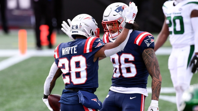 New England Patriots running back James White, tight end Devin Asiasi