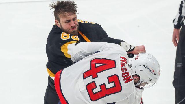 Boston Bruins defenseman Jarred Tinordi and Washington Capitals forward Tom Wilson
