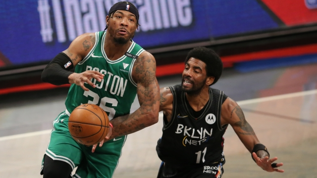 Boston Celtics point guard Marcus Smart, Brooklyn Nets guard Kyrie Irving