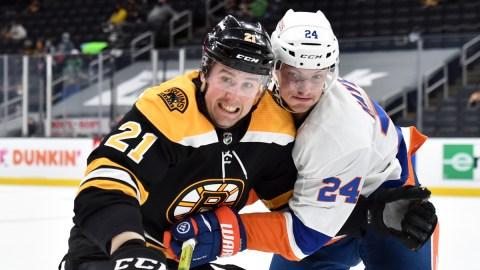 Boston Bruins left wing Nick Ritchie, New York Islanders defenseman Nick Leddy
