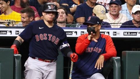 Boston Red Sox manager Alex Cora (13) and catcher Christian Vazquez (7)