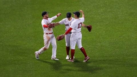 Boston Red Sox center fielder Kiké Hernández (5), right fielder Hunter Renfroe (10) and left fielder Alex Verdugo (99)