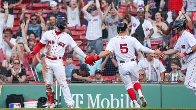 Boston Red Sox center fielder Kiké Hernández (5), left fielder Alex Verdugo (99) and catcher Kevin Plawecki (25)