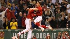 Boston Red Sox outfielders Alex Verdugo (left) and Kiké Hernández