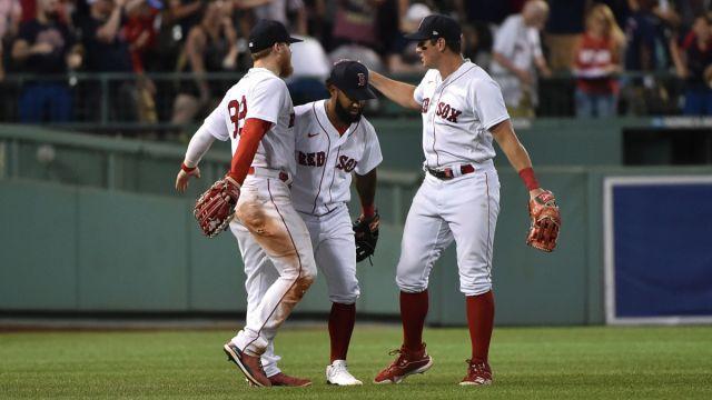 Boston Red Sox outfielders Alex Verdugo Danny Santana, and Hunter Renfroe
