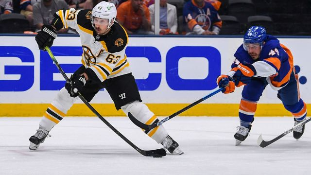 Boston Bruins left wing Brad Marchand and New York Islanders center Jean-Gabriel Pageau