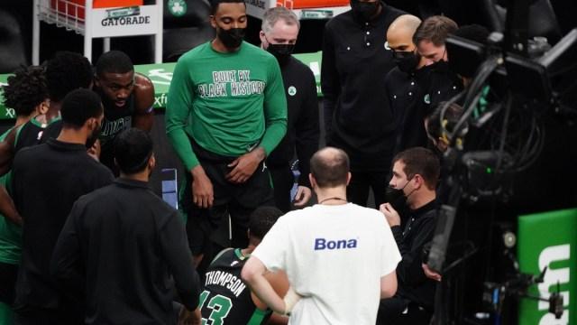Celtics coach Brad Stevens, assistant coach Jerome Allen and players