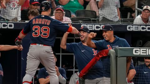 Boston Red Sox second baseman Christian Arroyo and manager Alex Cora