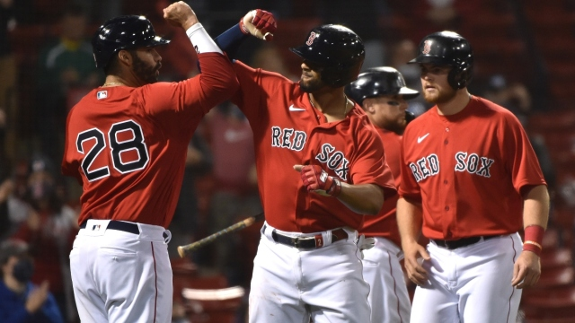 Red Sox left fielder J.D. Martinez (28) and shortstop Xander Bogaerts (2)