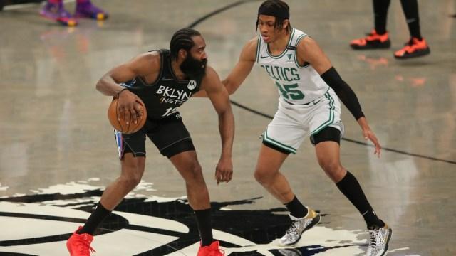 Brooklyn Nets shooting guard James Harden (13) and Boston Celtics shooting guard Romeo Langford (45)
