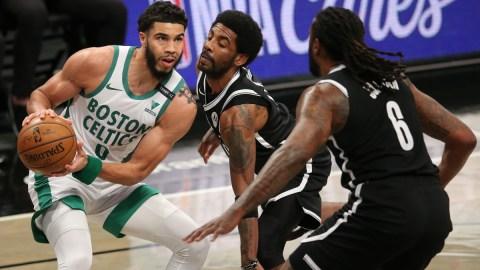 Boston Celtics forward Jayson Tatum (0), Brooklyn Nets point guard Kyrie Irving (11) and center DeAndre Jordan (6)