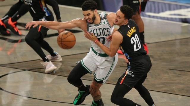 Boston Celtics small forward Jayson Tatum (0) and Brooklyn Nets shooting guard Landry Shamet (20)