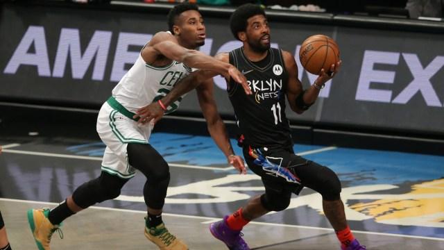 Brooklyn Nets point guard Kyrie Irving (11) and Boston Celtics small forward Aaron Nesmith (26)