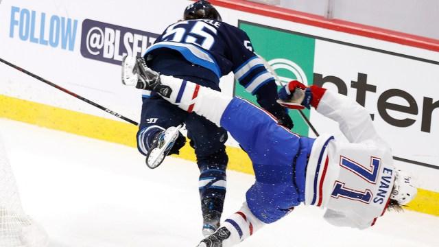 Winnipeg Jets forward Mark Scheifele, Montreal Canadiens forward Jake Evans