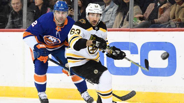 New York Islanders defenseman Nick Leddy and Boston Bruins left wing Brad Marchand