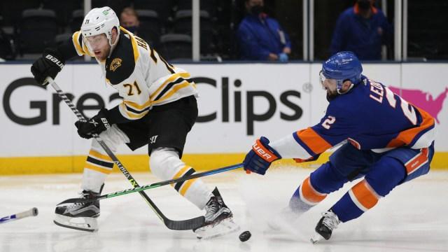 Boston Bruins winger Taylor Hall, New York Islanders defenseman Nick Leddy