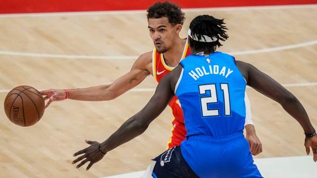 Atlanta Hawks guard Trae Young and Milwaukee Bucks guard Jrue Holiday