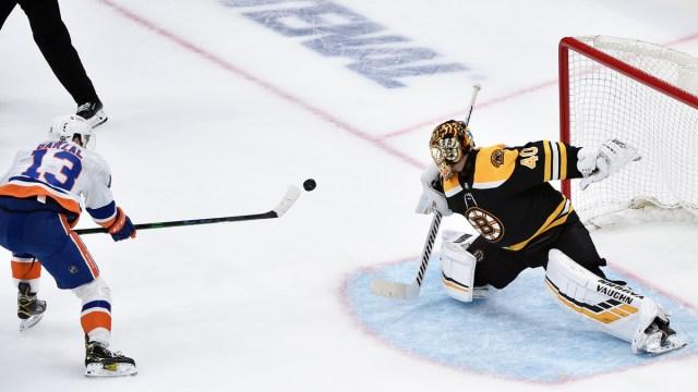 Boston Bruins goalie Tuukka Rask, New York Islanders forward Mat Barzal