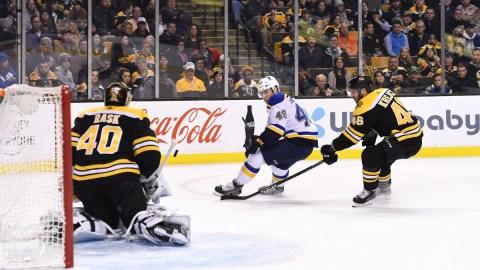 St. Louis Blues center Ivan Barbashev (49), Boston Bruins goaltender Tuukka Rask (40) and center David Krejci (46)