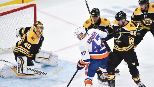 Boston Bruins goalie Tuukka Rask, New York Islanders forward Leo Komarov