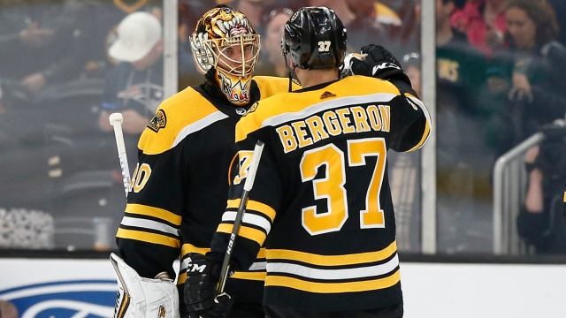 Boston Bruins Goalie Tuukka Rask And Center Patrice Bergeron