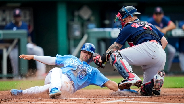 Kansas City Royals right fielder Whit Merrifield, Boston Red Sox catcher Christian Vazquez