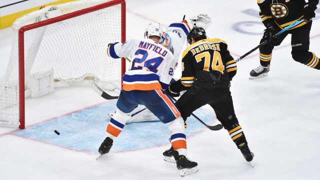 Boston Bruins winger Jake DeBrusk and New York Islanders defenseman Scott Mayfield