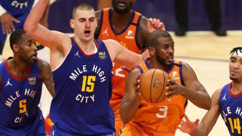 Denver Nuggets forward Nikola Jokic and Phoenix Suns guard Chris Paul