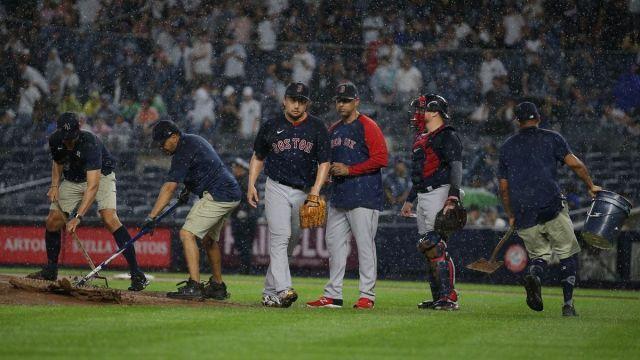 Boston Red Sox manager Alex Cora, pitcher Hirokazu Sawamura
