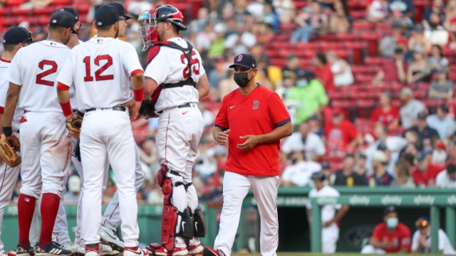 Boston Red Sox manager Alex Cora and players